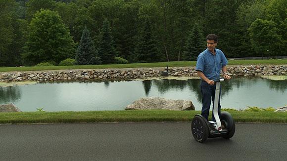 Dean Kamen riding his Segway