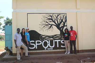 Kathy Ku (third from left) and her team standing in front of the first SPOUTS factory in Kumi, Uganda. (Courtesy of Kathy Ku)